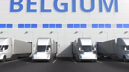 belgie : Trailer trucks at warehouse loading dock with PRODUCT OF BELGIUM text. Belgian logistics related 3D animation