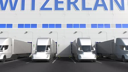 capacidade : Electric semi-trailer trucks at warehouse loading dock with PRODUCT OF SWITZERLAND text. Swiss logistics related 3D animation
