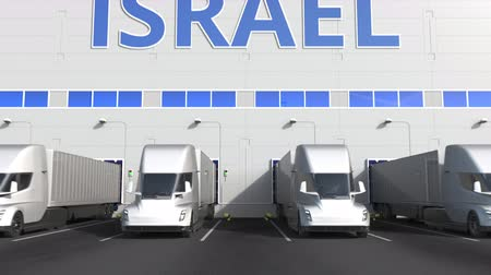 izrael : Electric semi-trailer trucks at warehouse loading dock with PRODUCT OF ISRAEL text. Israeli logistics related 3D animation