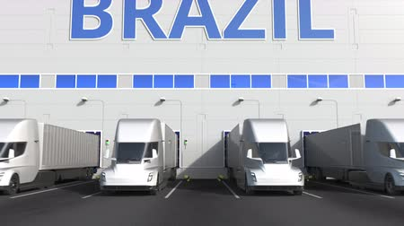 brezilya : Modern semi-trailer trucks at warehouse loading dock with PRODUCT OF BRAZIL text. Brazilian logistics related 3D animation Stok Video