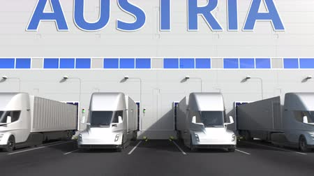 finland : Electric semi-trailer trucks at warehouse loading dock with PRODUCT OF AUSTRIA text. Venezuelan logistics related 3D animation