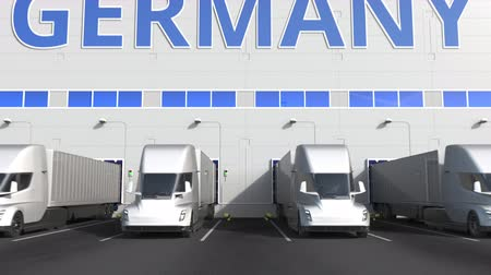 capacidade : Modern semi-trailer trucks at warehouse loading dock with PRODUCT OF GERMANY text. German logistics related 3D animation
