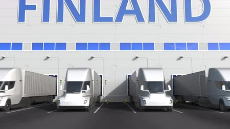 finland : Electric semi-trailer trucks at warehouse loading dock with PRODUCT OF FINLAND text. Finnish logistics related 3D animation