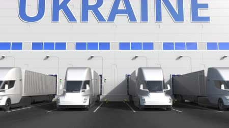 kapasite : Electric semi-trailer trucks at warehouse loading dock with PRODUCT OF UKRAINE text. Ukrainian logistics related 3D animation