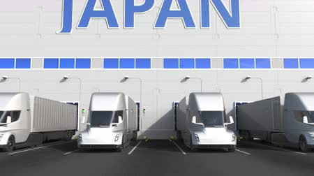 storing : Trailer trucks at warehouse loading dock with PRODUCT OF JAPAN text. Japanese logistics related 3D animation