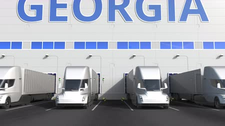 gürcü : Trailer trucks at warehouse loading dock with PRODUCT OF GEORGIA text. Georgian logistics related 3D animation