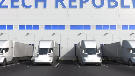 kapasite : Modern semi-trailer trucks at warehouse loading dock with PRODUCT OF CZECH REPUBLIC text. Logistics related 3D animation Stok Video