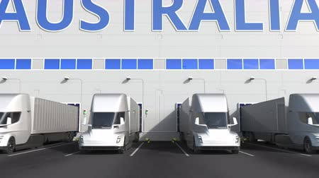 capacidade : Trailer trucks at warehouse loading dock with PRODUCT OF AUSTRALIA text. Australian logistics related 3D animation