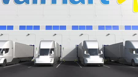 walmart : Electric semi-trailer trucks at warehouse loading bay with WALMART logo on the wall. Editorial 3D animation