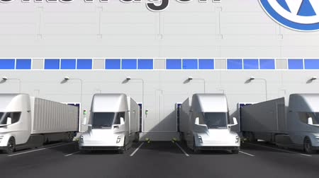 volkswagen : Electric semi-trailer trucks at warehouse loading bay with VOLKSWAGEN logo on the wall. Editorial 3D animation