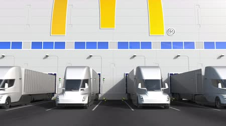 mcdonalds : Modern semi-trailer trucks at warehouse loading bay with MCDONALDS logo on the wall. Editorial 3D animation