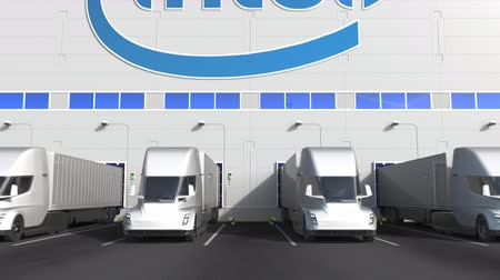 intel : Modern semi-trailer trucks at warehouse loading bay with INTEL logo on the wall. Editorial 3D animation