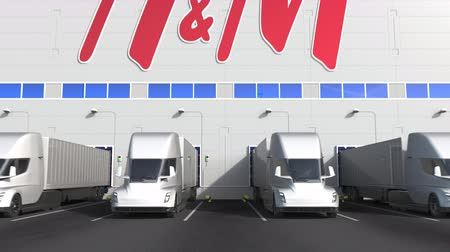 sziám : Electric semi-trailer trucks at warehouse loading bay with H&M logo on the wall. Editorial 3D animation