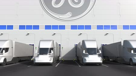 general electric : Electric semi-trailer trucks at warehouse loading bay with GENERAL ELECTRIC GE logo on the wall. Editorial 3D animation