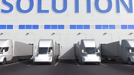 storing : Trailer trucks at warehouse loading dock with STORAGE SOLUTION text. 3D animation Stock Footage