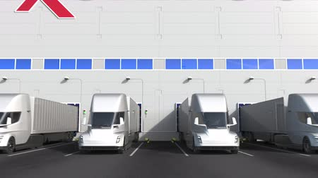 unload : Electric semi-trailer trucks at warehouse loading bay with EXXON MOBIL CORPORATION logo on the wall. Editorial 3D animation