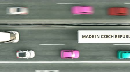 tcheco : Aerial top down view of semi-trailer trucks with MADE IN CZECH REPUBLIC text driving along the road. business related loopable 3D animation