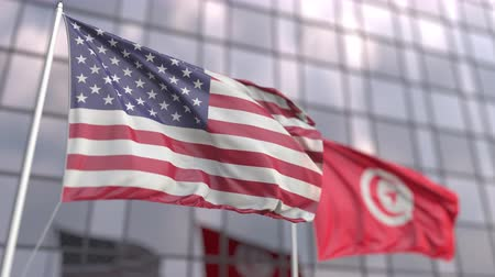siyasi : Waving flags of the United States and Tunisia in front of a modern skyscraper