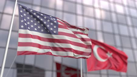 siyasi : Waving flags of the United States and Turkey in front of a modern skyscraper facade Stok Video