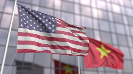 siyasi : Waving flags of the United States and Vietnam in front of a modern skyscraper
