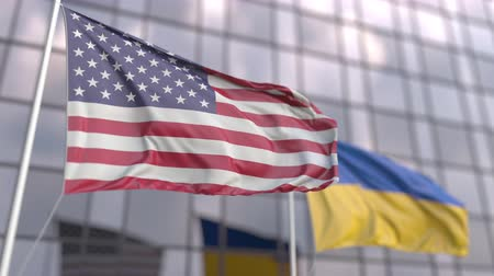 siyasi : Waving flags of the United States and Ukraine in front of a modern building facade