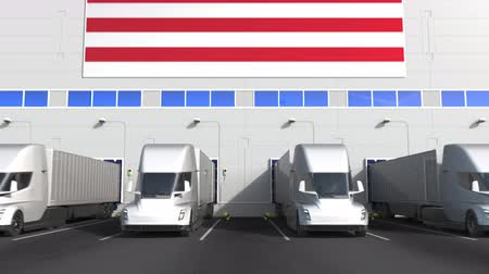 disposição : Electric semi-trailer trucks at warehouse loading dock with flag of MALAYSIA. Malaysian logistics related conceptual 3D animation Stock Footage
