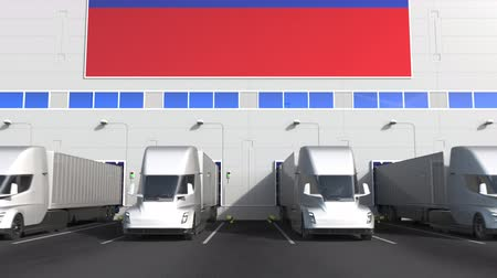 disposição : Electric semi-trailer trucks at warehouse loading bay with flag of RUSSIA. Russian logistics related conceptual 3D animation