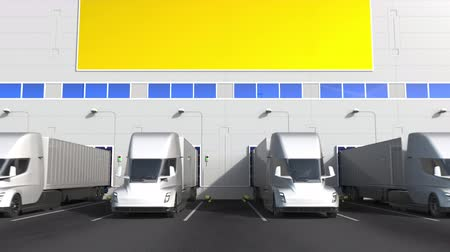 disposição : Electric semi-trailer trucks at warehouse loading dock with flag of UKRAINE. Ukrainian logistics related conceptual 3D animation Stock Footage