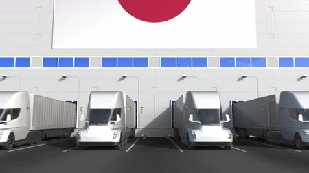 disposição : Trailer trucks at warehouse loading bay with flag of JAPAN. Japanese logistics related conceptual 3D animation