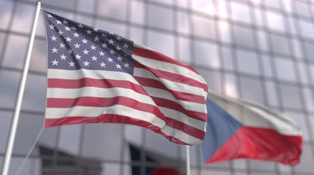bandeira americana : Waving flags of the United States and the Czech Republic in front of a modern skyscraper facade