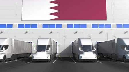 disposição : Modern trailer trucks at warehouse loading bay with flag of QATAR. Qatari logistics related conceptual 3D animation Stock Footage
