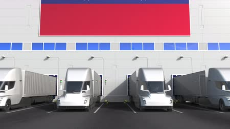 disposição : Semi-trailer trucks at warehouse loading dock with flag of VENEZUELA. Venezuelan logistics related conceptual 3D animation