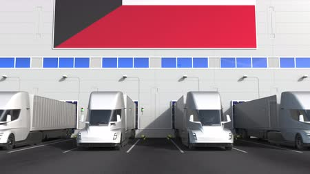 disposição : Electric trailer trucks at warehouse loading bay with flag of KUWAIT. Kuwaiti logistics related conceptual 3D animation