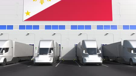işlemek : Electric trucks at warehouse loading bay with flag of THE PHILIPPINES. Logistics related conceptual 3D animation Stok Video
