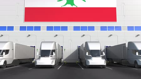 disposição : Trailer trucks at warehouse loading bay with flag of LEBANON. Lebanese logistics related conceptual 3D animation