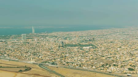telhado : Aerial view of Al Barsha districts area and distant World Islands in Dubai, UAE