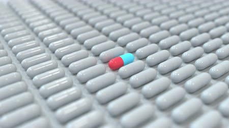 farmacologia : Red and blue drug capsule among many grey ones. Pharmaceutical search related conceptual 3D animation Stock Footage