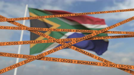 border crossing : Caution biohazard tape with flag of South Africa as a background. South African restricted border crossing or quarantine. Conceptual looping 3D animation