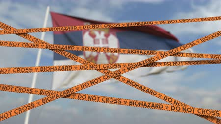 sérvia : Biohazard restriction tape lines against the Serbian flag. Restricted border crossing or quarantine in Serbia. Conceptual looping 3D animation