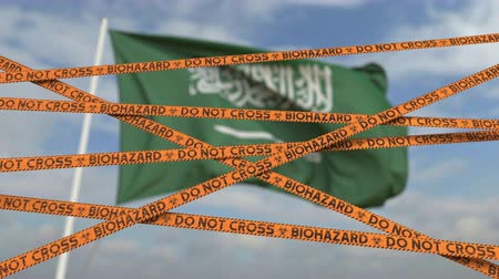 しない : Do not cross biohazard tape lines on the Saudi Arabian flag background. Restricted entry or quarantine in Saudi Arabia. Conceptual looping 3D animation 動画素材