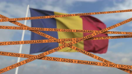 romeno : Do not cross biohazard tape lines on the Romanian flag background. Restricted entry or quarantine in Romania. Conceptual looping 3D animation Stock Footage