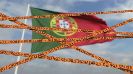 níveis : Do not cross biohazard tape lines on the Portuguese flag background. Restricted entry or quarantine in Portugal. Conceptual looping 3D animation
