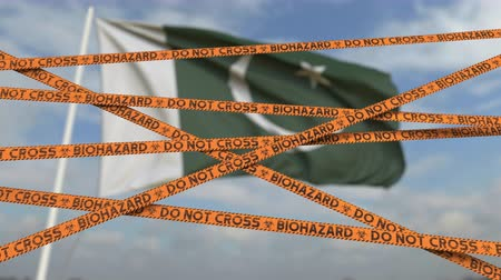 しない : Caution biohazard tape with flag of Pakistan as a background. Pakistani restricted entry or quarantine. Conceptual looping 3D animation