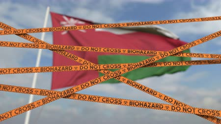 bariéra : Biohazard restriction tape lines against the Omani flag. Restricted entry or quarantine in Oman. Conceptual looping 3D animation