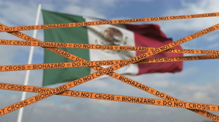 teszi : Biohazard restriction tape lines against the Mexican flag. Restricted border crossing or quarantine in Mexico. Conceptual looping 3D animation