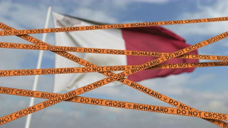 border crossing : Biohazard restriction tape lines against the Maltese flag. Restricted border crossing or quarantine in Malta. Conceptual looping 3D animation