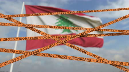 border crossing : Biohazard restriction tape lines against the Lebanese flag. Restricted border crossing or quarantine in Lebanon. Conceptual looping 3D animation Stock Footage