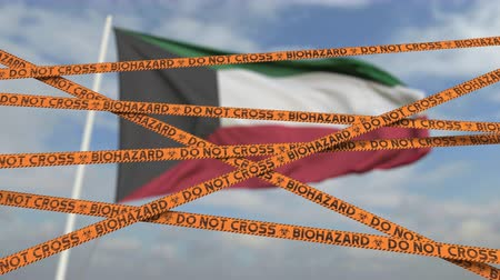 border crossing : Biohazard restriction tape lines against the Kuwaiti flag. Restricted border crossing or quarantine in Kuwait. Conceptual looping 3D animation Stock Footage
