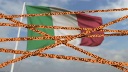 border crossing : Biohazard restriction tape lines against the Italian flag. Restricted border crossing or quarantine in Italy. Conceptual looping 3D animation