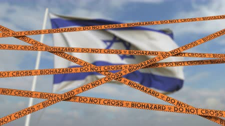 izrael : Do not cross biohazard tape lines on the Israeli flag background. Restricted border crossing or quarantine in Israel. Conceptual looping 3D animation
